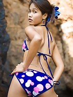 Slender Asian teen Lily Koh takes off bikini top outside