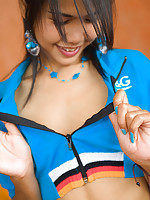 Thai cutie unzips shirt and flashes petite brown titties