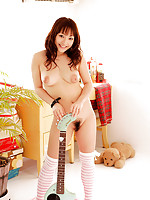 Kotono Asian in white bikini plays with her hard to resist boobs