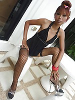 Skinny redhead Thai slut Malai is outside and strips to show off her leggy body