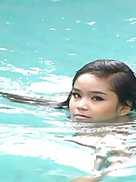 Tiny Thai babe Panni swimming nude outside at the pool