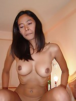 Thai girlfriend with perfect tits sucks a big white cock
