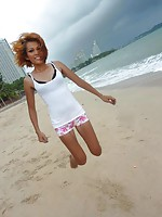 Skinny thai poses and shows her pussy on the beach
