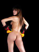 Shanya posing nude in boxing cloves