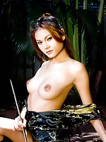 Riyo posing topless with a sword