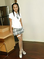 Schoolgirl Thai babe May comes over and strips out of her sexy outfit