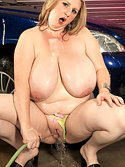 Big hottie gets wet while washing car