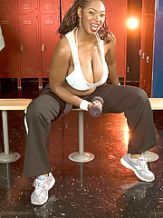 Busty black girl strips in locker room
