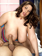 Voluptuous brunette gets her tits painted
