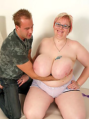 This hot BBW milf is helping her sons friend out when she notices the huge boner he has for her and decides to drink the cum out of the throbbing rod.