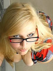 Secretary in seamed stockings and glasses stripping