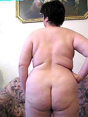 Old chubby grandma shows her huge wrinkled buns