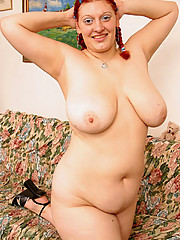 Cute young fatty rubs her enormous soft melons