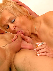 Wrinkled blonde granny goes down on a young guy