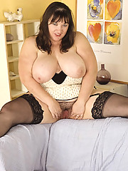 Fat housewife posing in sexy black stockings only