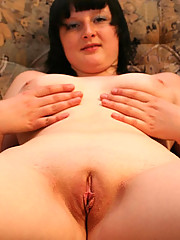 Chubby brunette massages her yummy shaven pussy