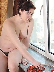Plump hottie gets stripped in front of the window