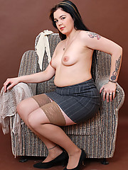 Naughty tattooed plumper in sexy tight stockings