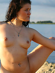 Dreamboat young plumper posing nude at rocky shore