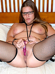 Plump girlie in glasses gets rid of silk lingerie