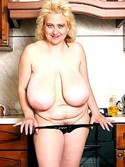 Kinky plump woman shows giant tits