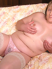 Older chubby in stockings getting naked