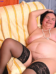 Granny in black stockings shows everything