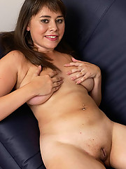 Beautiful shaved chubby playing with dildo