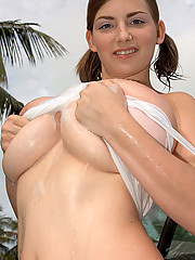 Christy Marks gets wet while washing car