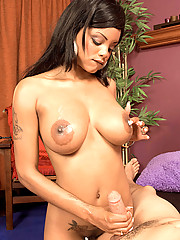 Black cutie gives a spirited tugjob