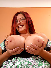 Red head plumper gets rammed by a big black cock as she creams all over it.
