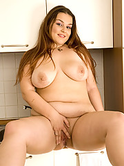 Beautiful fatty demonstrates her curves in kitchen