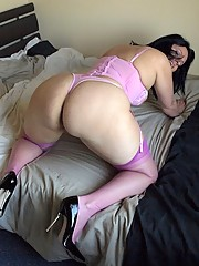 Big ass housewife Daniella gets horny in pink basque and stockings