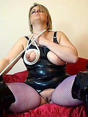 Kinky tied up wife in rubber and thigh boots waits to be fucked