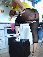 Daniella ripping open her black sheer footless pantyhose