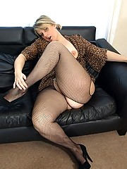 Filthy milf shows off her cunt in open crotch fishnets