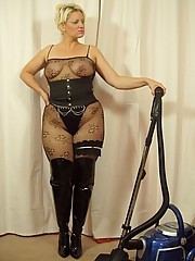 Kinky thigh booted Daniella doing the hoovering in her bodystocking