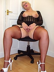 Buxom milf Daniella in sheer dress and nylons shows off her cunt