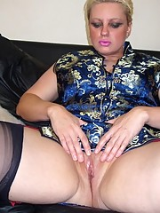 Stern milf in oriental dress and black seamed nylons