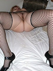Milf dressed like a slut in fishnets and mini