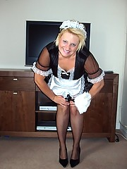 Saucy French maid in black thigh high stockings
