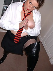 Kinky schoolgirl in fishnets and boots