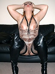Dominatrix in high boots and stockings