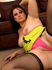 Big ass English slut in lime green dress, seamed stockings and suspenders