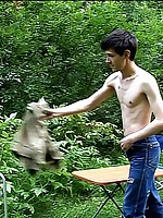 Cute dark-haired dude is whipped hard in the forest
