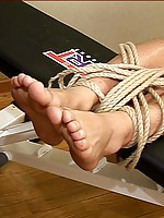 Hot twink tries to wriggle out of intricate bondage