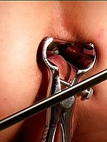 Deep speculum exploration for a submissive guy
