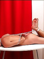 Thin guy sub masked and tied for spanking on table