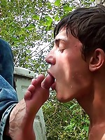 Cute boyperforms a mind-blowing foot job in forest
