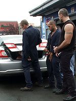 Spencer Reed and a bunch of car mechanics take turns fucking Gianni Lucca in a public auto garage.